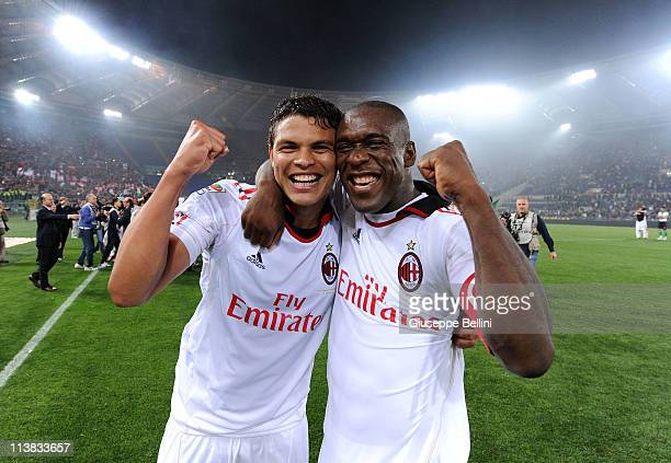 Thiago Siva and Clarence Seedorf of Milan celebrate the victory after the Serie A match between AS Roma and AC Milan at Stadio Olimpico on May 7,...