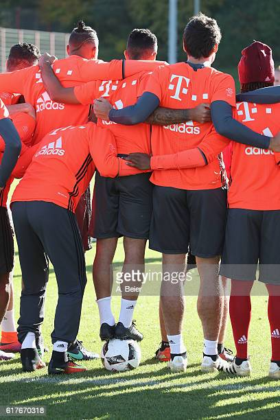 Thiago standing on a soccer ball and teammates of FC Bayern Muenchen make ateam photograph during a training session at the club's Saebener Strasse...