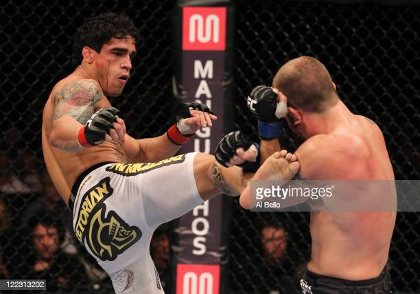 Thiago Tavares kicks Spencer Fisher during a lightweight bout at UFC 134 at HSBC Arena on August 27 2011 in Rio de Janeiro Brazil