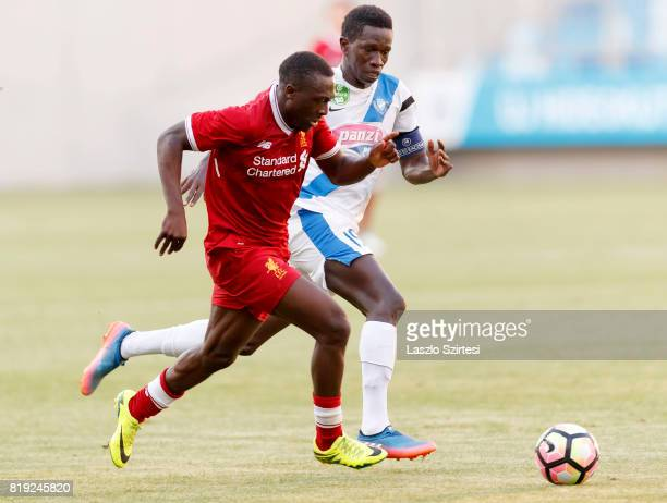Thiam Khaly Iyane of MTK Budapest II competes for the ball with Bobby Adekanye of FC Liverpool U23 during the Preseason Friendly match between MTK...
