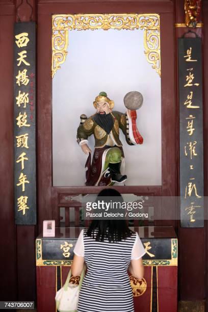 Thian Hock Keng Temple.  Tai Yang Gong : The Sun God. Woman praying.  Singapore.