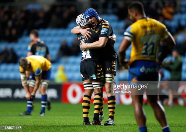 Thibaud Flament and Nizaam Carr of the Wasps celebrate beating Bath Rugby during the Gallagher Premiership Rugby match between Wasps and Bath Rugby...