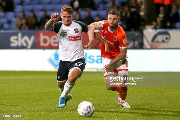 Thibaud Verlinden of Bolton Wanderers is challenged by James Husband of Blackpool FC during the Sky Bet Leauge One match between Bolton Wanderers and...