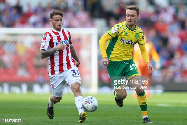 Thibaud Verlinden of Stoke City and Tom Trybull of Norwich City during the Sky Bet Championship match between Stoke City and Norwich City at Bet365...