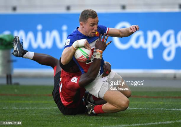 Thibauld Mazzoleni of France scores a try while tackled by Erick Ombasa of Kenya during day 1 of the HSBC Cape Town Sevens Pool C match 19 between...