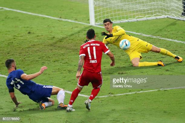 Thibault Courtois of Chelsea saves a shot from James Rodriguez of Bayern Munich during the International Champions Cup match between Chelsea FC and...