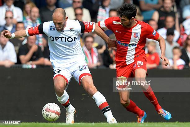Thibault Peyre of Mouscron battles for the ball with Bjorn Ruytinx of OH Leuven during match day 1 of the Final Round in the second division match...