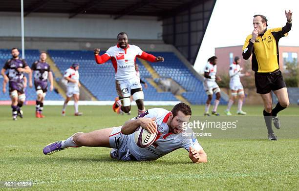 Thibault Regard of Lyon dives over to score his team's first try of the game during the European Rugby Challenge Cup match between London Welsh and...