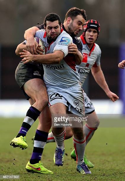 Thibault Regard of Lyon is tackled by Olly Barkley of London Welsh during the European Rugby Challenge Cup match between London Welsh and Lyon Rugby...