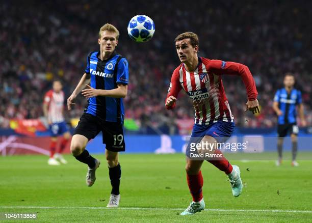 Thibault Vlietinck of Club Brugge and Antoine Griezmann of Atletico Madrid in action during the Group A match of the UEFA Champions League between...