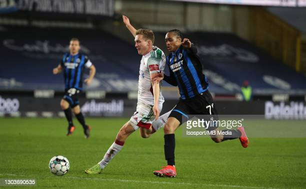 Thibault Vlietinck of OHL battles for the ball with Tahith Chong of Club Brugge during the Jupiler Pro League match between Club Brugge and OHL at...