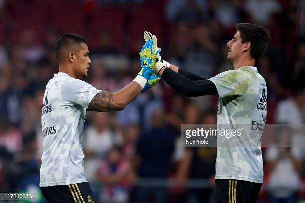 Thibaut Courtois and Areola of Real Madrid greets during the Liga match between Club Atletico de Madrid and Real Madrid CF at Wanda Metropolitano on...