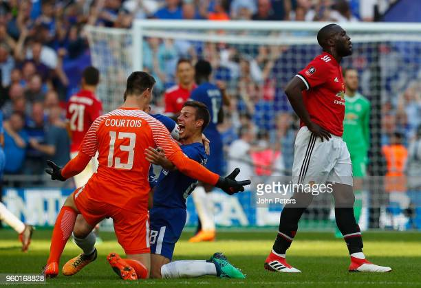 Thibaut Courtois and Cesar Azpilicueta of Chelsea celebrate after the Emirates FA Cup Final match between Manchester United and Chelsea at Wembley...