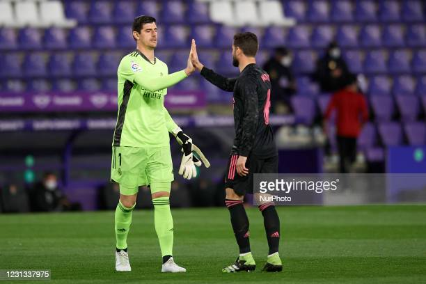 Thibaut Courtois and Nacho Fernandez of Real Madrid greets each other during the La Liga Santander match between Real Valladolid CF and Real Madrid...