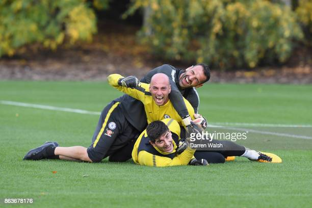 Thibaut Courtois, Eduardo and Willy Caballero of Chelsea during a training session at Chelsea Training Ground on October 20, 2017 in Cobham, United...