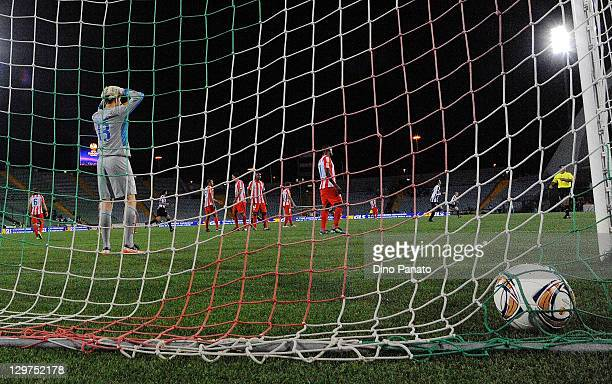 Thibaut Courtois goal kepeer of Atletico de Madrid dshows his dejection after the second Udinese goal during the UEFA Europa League group I match...