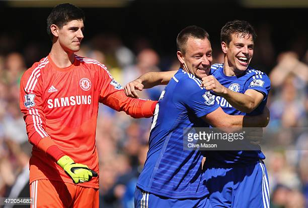 Thibaut Courtois John Terry and Cesar Azpilicueta celebrate winning the Premier League title after the Barclays Premier League match between Chelsea...