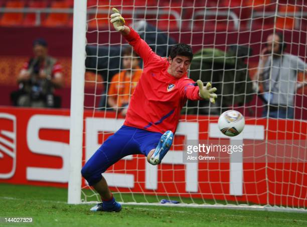 Thibaut Courtois of Atletico Madrid fails to stop a shot during the Atletico Madrid training session ahead of the UEFA Europa League Final between...
