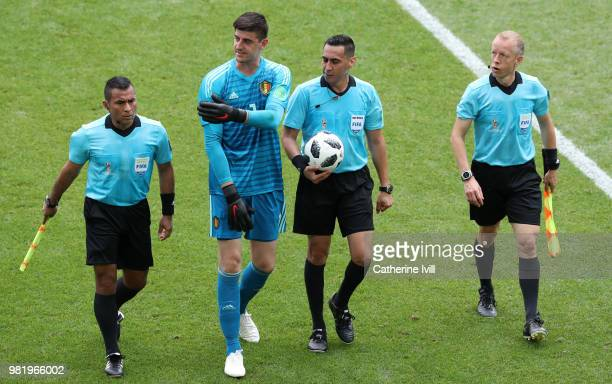 Thibaut Courtois of Belgium and the match officials make their way to the tunnel at half time during the 2018 FIFA World Cup Russia group G match...