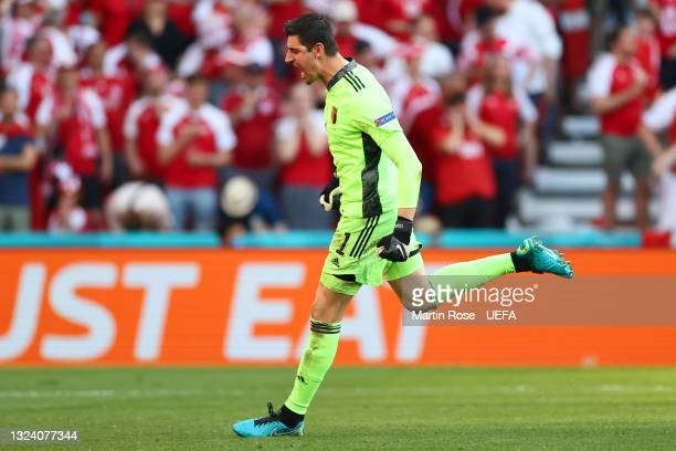 Thibaut Courtois of Belgium celebrates after their side's second goal scored by Kevin De Bruyne during the UEFA Euro 2020 Championship Group B match...