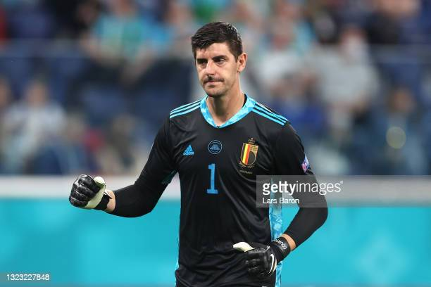 Thibaut Courtois of Belgium celebrates their side's first goal scored by team mate Romelu Lukaku during the UEFA Euro 2020 Championship Group B match...