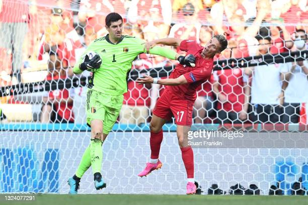 Thibaut Courtois of Belgium clashes with Jens Stryger Larsen of Denmark during the UEFA Euro 2020 Championship Group B match between Denmark and...