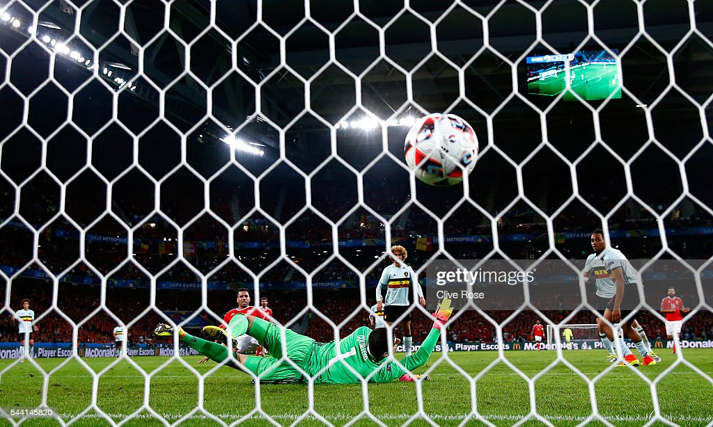 Thibaut Courtois of Belgium dives in vain as Hal Robson-Kanu of Wales scores his team's second goal during the UEFA EURO 2016 quarter final match between Wales and Belgium at Stade Pierre-Mauroy on July 1, 2016 in Lille, France.