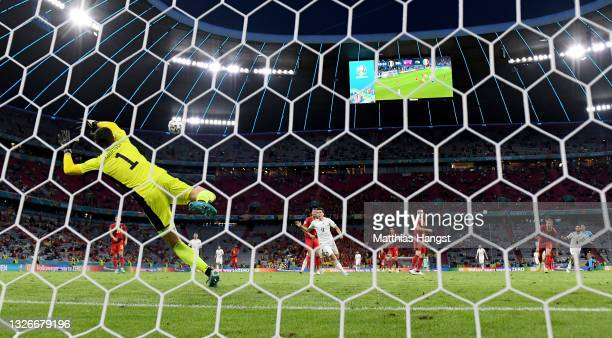 Thibaut Courtois of Belgium fails to save the Italy second goal scored by Lorenzo Insigne during the UEFA Euro 2020 Championship Quarter-final match...