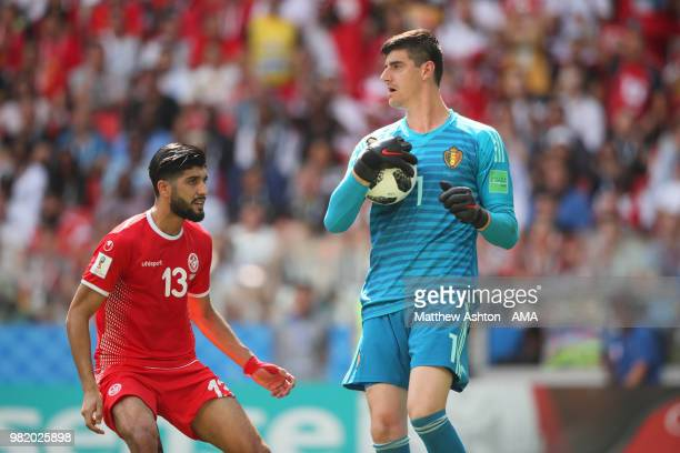 Thibaut Courtois of Belgium in action under pressure from Ferjani Sassi of Tunisia during the 2018 FIFA World Cup Russia group G match between...