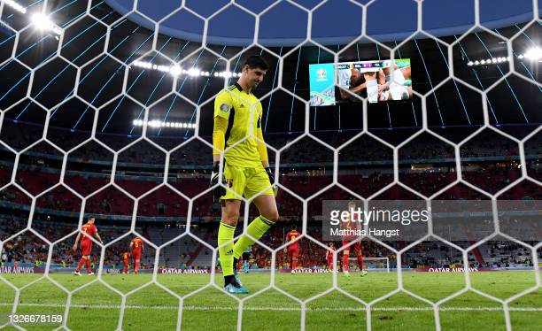 Thibaut Courtois of Belgium looks dejected after the Italy first goal scored by Nicolo Barella during the UEFA Euro 2020 Championship Quarter-final...