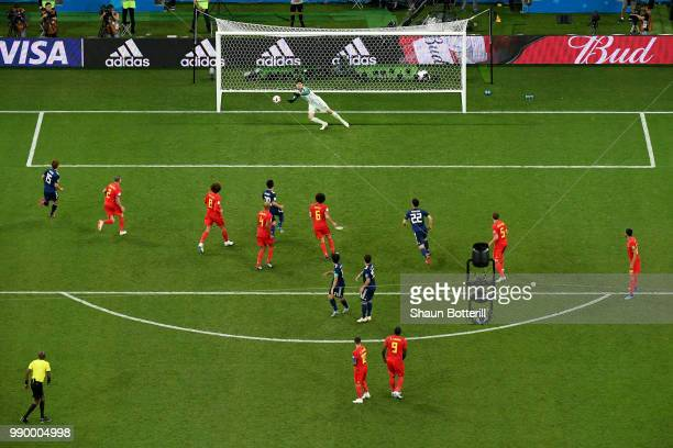 Thibaut Courtois of Belgium makes a saves from a long range freekick from Keisuke Honda of Japan during the 2018 FIFA World Cup Russia Round of 16...