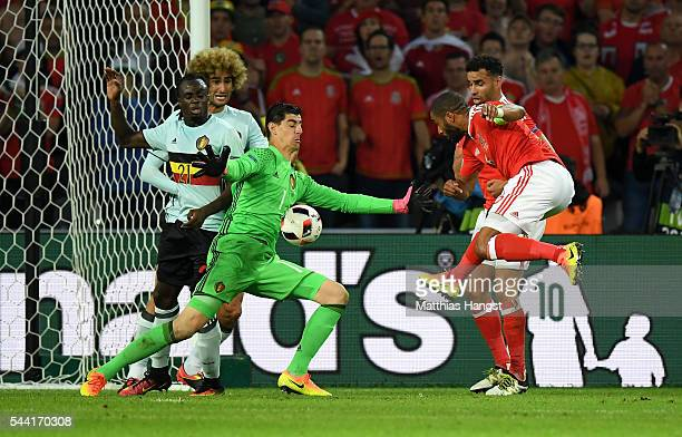 Thibaut Courtois of Belgium saves the shot by Ashley Williams of Wales during the UEFA EURO 2016 quarter final match between Wales and Belgium at...