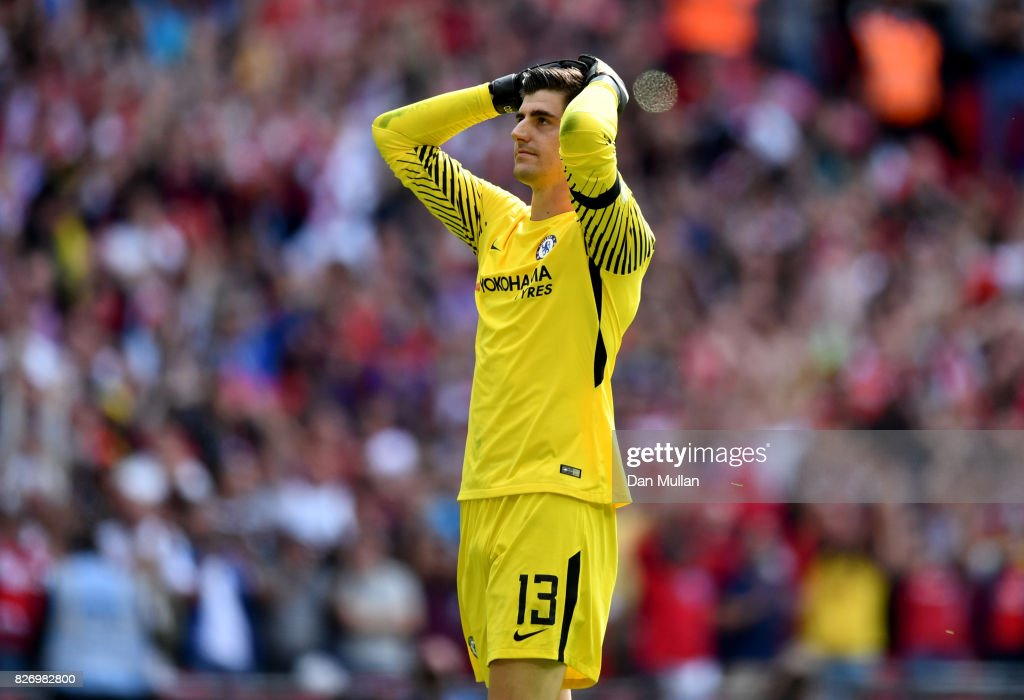 Thibaut Courtois of Chelea reacts to missing his sides second penalty during the The FA Community Shield final between Chelsea and Arsenal at Wembley Stadium on August 6, 2017 in London, England.