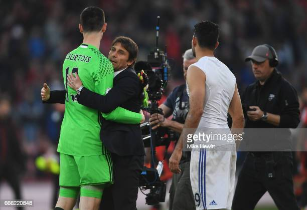 Thibaut Courtois of Chelsea and Antonio Conte Manager of Chelsea embrace after the Premier League match between AFC Bournemouth and Chelsea at...