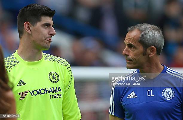 Thibaut Courtois of Chelsea and coach Christophe Lollichon after the Barclays Premier League match between Chelsea and Leicester City at Stamford...