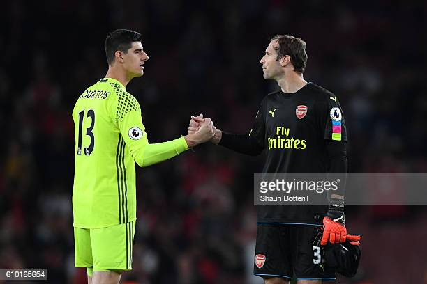 Thibaut Courtois of Chelsea and Petr Cech of Arsenal shake hands after the final whistle during the Premier League match between Arsenal and Chelsea...