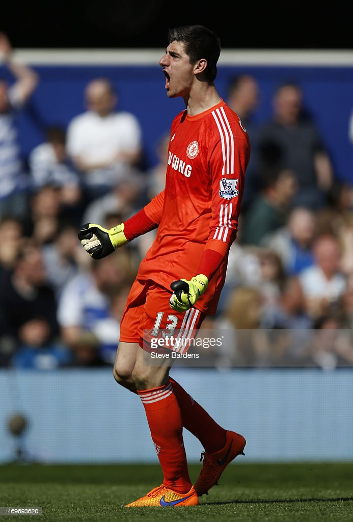 Thibaut Courtois of Chelsea celebrates during the Barclays Premier League match between Queens Park Rangers and Chelsea at Loftus Road on April 12, 2015 in London, England.