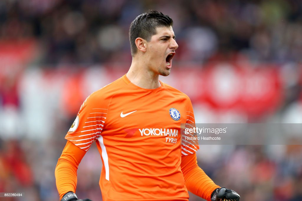 Thibaut Courtois of Chelsea celebrates his side's first goal during the Premier League match between Stoke City and Chelsea at Bet365 Stadium on September 23, 2017 in Stoke on Trent, England.
