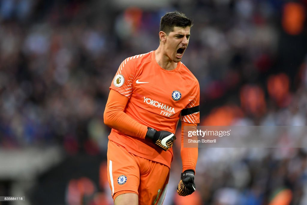 Thibaut Courtois of Chelsea celebrates his sides second goal during the Premier League match between Tottenham Hotspur and Chelsea at Wembley Stadium on August 20, 2017 in London, England.