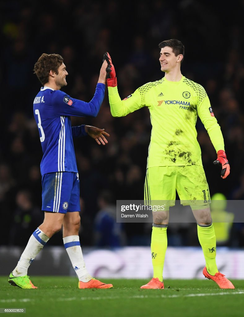 Thibaut Courtois of Chelsea celebrates victory with Marcos Alonso of Chelsea after The Emirates FA Cup Quarter-Final match between Chelsea and Manchester United at Stamford Bridge on March 13, 2017 in London, England.