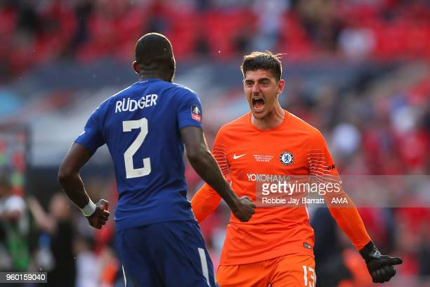 Thibaut Courtois of Chelsea celebrates with Antonio Rudiger at the end of the Emirates FA Cup Final between Chelsea and Manchester United at Wembley...