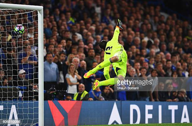 Thibaut Courtois of Chelsea dives in vain as Jordan Henderson of Liverpool scores their second goal during the Premier League match between Chelsea...