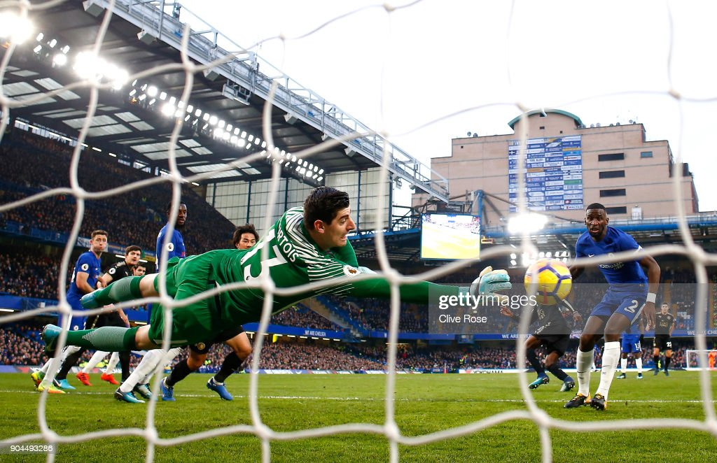Thibaut Courtois of Chelsea dives to make a save during the Premier League match between Chelsea and Leicester City at Stamford Bridge on January 13, 2018 in London, England.