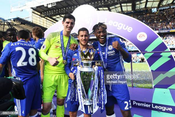Thibaut Courtois of Chelsea Eden Hazard of Chelsea and Michy Batshuayi of Chelse pose with the Premier League Trophy after the Premier League match...