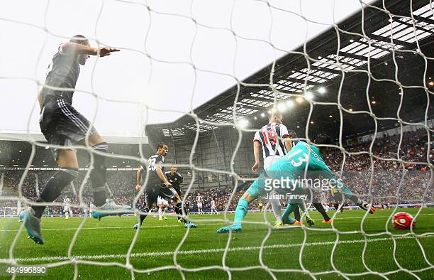 Thibaut Courtois of Chelsea fails to stop the opening goal by James Morrison of West Bromwich Albion during the Barclays Premier League match between...