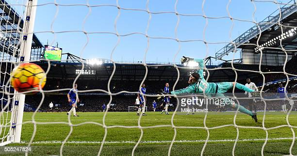 Thibaut Courtois of Chelsea fails to stop the shot by Kevin Mirallas of Everton during the Barclays Premier League match between Chelsea and Everton...