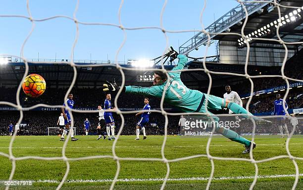 Thibaut Courtois of Chelsea fails to stop the shot by Kevin Mirallas of Everton allowing Everton's second goal during the Barclays Premier League...