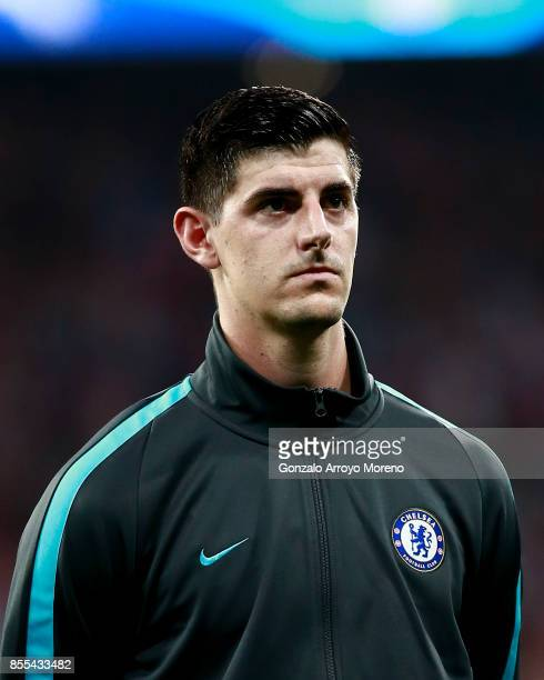 Thibaut Courtois of Chelsea FC listens to the UEFA Champions League hymn prior to start the UEFA Champions League group C match between Atletico...