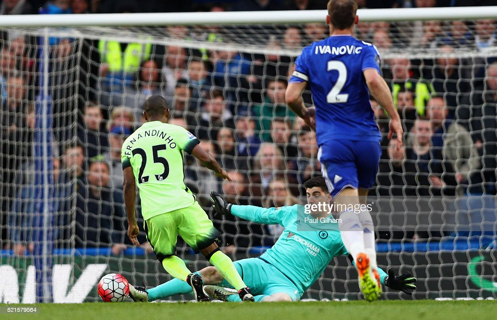 Thibaut Courtois of Chelsea fouls Fernandinho of Manchester City to conceed a penalty during the Barclays Premier League match between Chelsea and Manchester City at Stamford Bridge on April 16, 2016 in London, England.