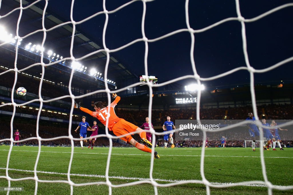Thibaut Courtois of Chelsea is beaten by Kevin De Bruyne of Manchester City (not pictured) for Manchester City first goal during the Premier League match between Chelsea and Manchester City at Stamford Bridge on September 30, 2017 in London, England.